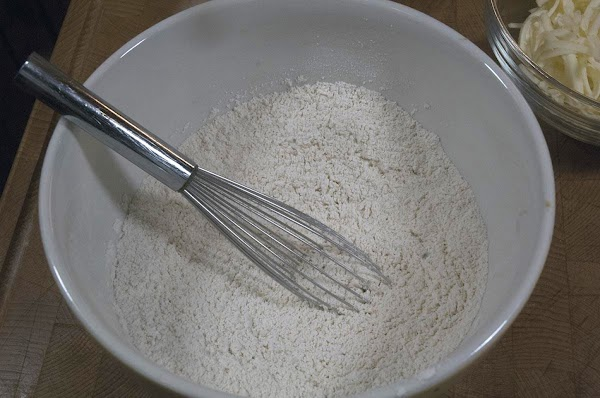 Take the dry ingredients (flour, baking powder, and salt), and whisk together in a...