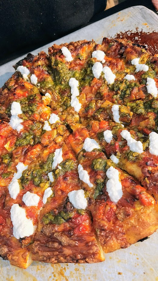 Pizza Jerk cast iron pizza for Pie Harder 2017 was a boasted a cornucopia of veggies, truffled ricotta, and late summer pesto with veggies from their own garden.