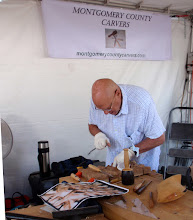 Photo: Joe working on a carving, maybe the next purple ribbon?