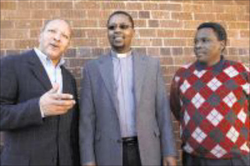 INFLUENTIAL: Businessman Simon Mohapi, Past or Sikhosiphi Mgoza and Dr Sipho Nkosi of the St Phillip Catholic Church PIC: MOHAU MOFOKENG. 30/07/2009. © Sowetan.   30 JULY 2009 MMO -- Businessman Simon Mohapi, Pastor Sikhosiphi Mgoza and Dr Sipho Nkosi organizers of the St Phillip Catholic Church business conference standing outside the church in Soweto . PHOTO MOHAU MOFOKENG