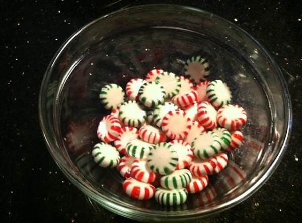 FIRST UNWRAP MINTS N COVER A COOKIE SHEET WITH PARCHMENT PAPER. PLACE BOWL UPSIDE...
