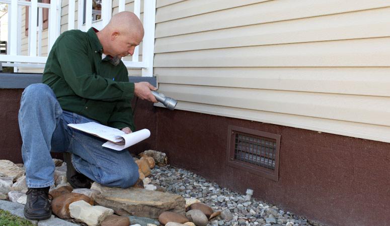 A man conducting a home appraisal