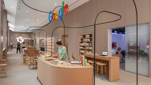 Several people wearing masks and exploring the inside of the Google Store in New York
