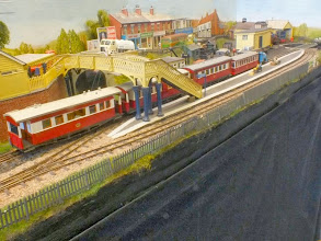 Photo: 004 The station and town area with a passenger train arriving .