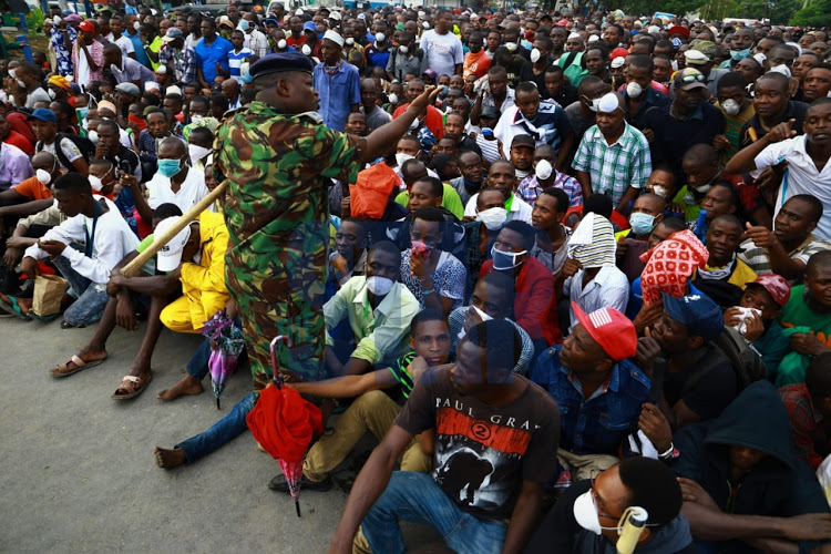 Mombasa residents rounded up before the start of the curfew on March 27, 2020.