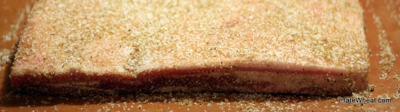 Photo: Pork belly covered in a cure rub of kosher salt, brown sugar, and some black pepper