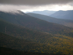 Photo: View southward through Crawford Notch. The sharp peak on the horizon, left of center, may be either Passaconaway or East Osceola.