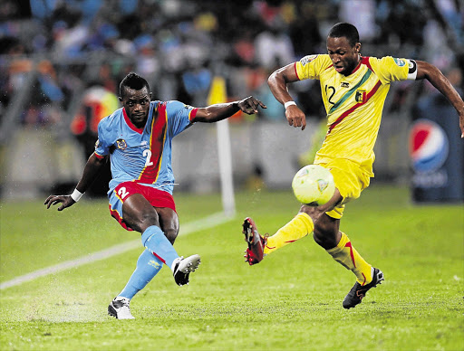 Parfait Mandanda of the Democratic Republic Congo and Syedou Keita of Mali tussle for possession of the ball during last night's clash at Moses Mabhida Stadium in Durban. Mali will meet Bafana Bafana in the quarterfinals Picture: ANESH DEBIKY/GALLO IMAGES