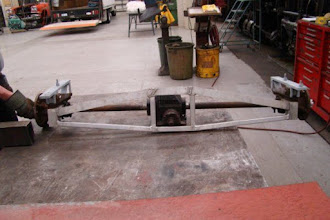 Photo: Rear axle flipped on frame to investigate the mounting geometry .