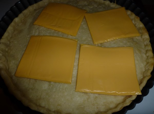 Bake pre-made or home made pie crust in tart pan (or pie dish) for...