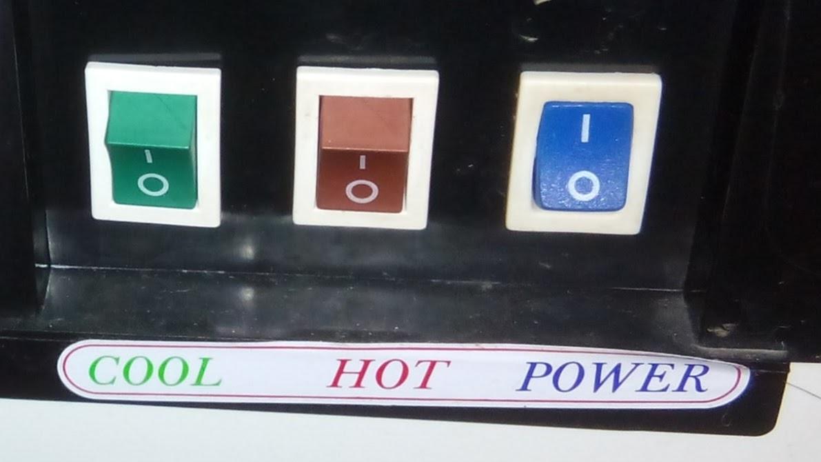 Tombol pada panel belakang dispenser galon bawah Miyako WDP-300