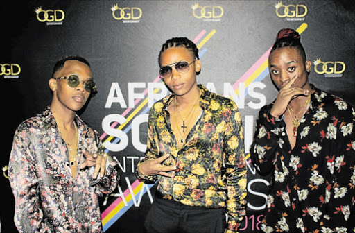 IN THE FAST LANE: Asanda Empires artists ARTeast, Kay and Takwana at the African Social Entertainment Awards in Johannesburg at the weekend. Their label scooped best record label award Picture: SUPPLIED