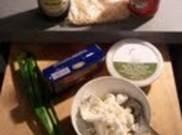 Mix cheeses, hot sauce, soy sauce and green onions in a bowl.  Mix...