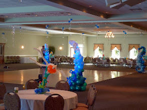 Photo: Long view of Under the Sea themed Grand Haven High School Prom 2011 at Trillium Banquet Hall, Spring Lake, Michigan (Awesome place!) 7' tall waves, seahorses, swimming centerpieces and hanging topiary, everything was lighted!
