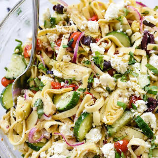 Greek Pasta Salad with Cucumbers and Artichoke Hearts.