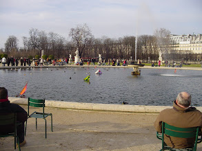 Photo: The weather is cool but clearing, and there is a good crowd in the Tuileries, and toy boats in the fountain which children steer with large sticks when they reach the edge.
