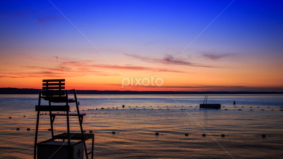 On the lake by Chad W - Landscapes Sunsets & Sunrises ( water, reflection, sun set, sky, blue, set, lake, sun )