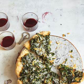 Kale, Caramelized Onion, and Parmesan Pizza
