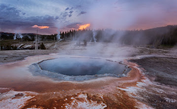 Photo: Geyser Land, Yellowstone National Park, WY#PhotographyWorkflow, #howtophotograph Geysers at Yellowstone often create their own localized weather (such as fog). On this occasion the side light provided an perfect opportunity to capture the steam. The brilliant reds of the bacterial mats in the foreground provided a perfect foreground.How was this image created?Steam and Mist are some of the hardest things to photograph if they break the horizon because you cant use a GND filters without making them look very unnatural. Even in manual blending it requires careful processing. To capture this photograph, I waited until the steam from the hot spring was dispersed enough to showcase interesting patterns.Enjoy & Share._______