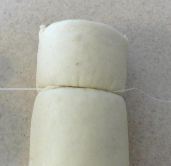 Using a piece of plain unflavored and unwaxed dental floss, cut the log into...