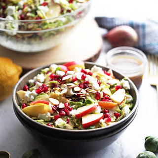 Shaved Brussels Sprouts and Pomegranate Salad with Lemon Balsamic Vinaigrette.
