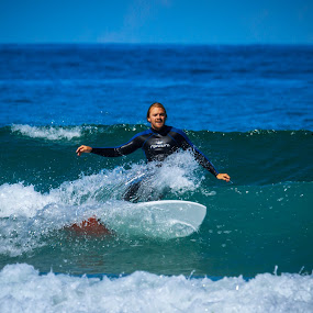 Surfing the waves by Vincent Yates - Uncategorized All Uncategorized ( surfer, waves, ocean, blue, surfing, crashing,  )