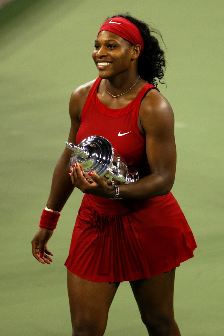 Serena Williams holds her trophy after winning at the 2008 US Open in New York. (Photo by Andrew Harrer/Bloomberg via Getty Images)