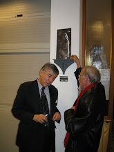 Photo: Dr. Jean-Pierre and Christian chat under the miniature of Paul's statue.  (Desktop copies of the statue may become available for sale to family members by special order.)