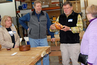 Photo: Richard Webster starts off the Show & Tell Critique explaining his yew bowl to the panelists, wood sculptor Lynda Smith-Bugge, wood-art collector Steve Keeble, and potter Ingrid D. Barnes.