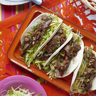 Smoky Barbecued Beef Tacos with Tomato Dressing.