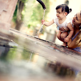 Mother and child by Dušan Marčeta - People Family ( water, love, girl, mother, happy, children, baby, smile, mom with kids )
