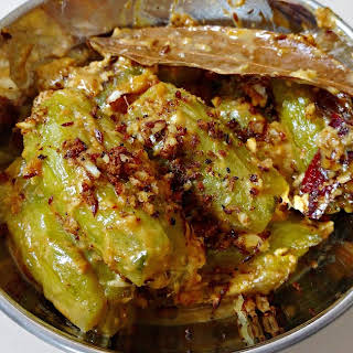 Narkel Potol - Pointed Gourd / Parwal curry in coconut gravy.