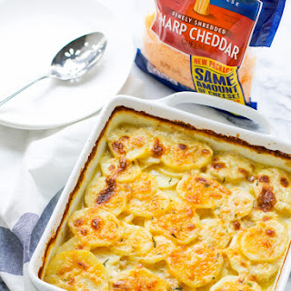 Scalloped Potatoes With Cheddar.