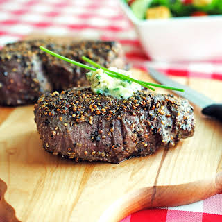 Pepper-Crusted Filet Mignons with Blue Cheese-Chive Butter.