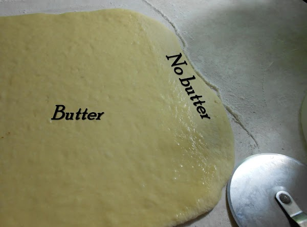 Roll out into rectangle.  Brush with melted butter but leave about an inch...