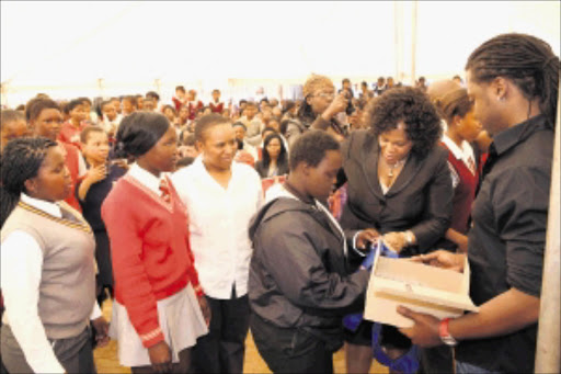 MOTHERLY LOVE: Gauteng Premier Nomvula Mokonyane brought joy to many poor female pupils in Zuurbekom on Wednesday when she handed out sanitary towels and toiletries. PHOTO: GPG