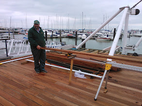 Photo: Nearly ready for the opening! Geoff Sowerby preparing to cut one of the last planks to size.