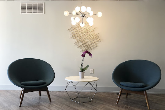 Lobby seating area with modern chairs and end table