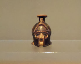Photo: Perfume vessel in the shape of a helmeted warrior's head, 600-590 BC, Cerveteri Museum