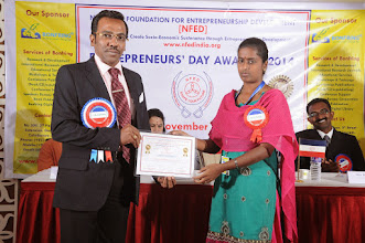 Photo: Prof. Dr. R. Ganesan, Chairman, NFED Issuing Certificate of Appreciation To Ms. Janani Sundrarajan, Research Analyst, Bonfring, Coimbatore
