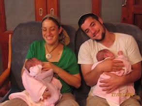 Photo: Amana holding Netta and Aharon holding Herut