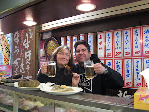 Photo: The master's wife took this for us. The signs behind us are entrees and prices. Kampai!!! (look it up.)