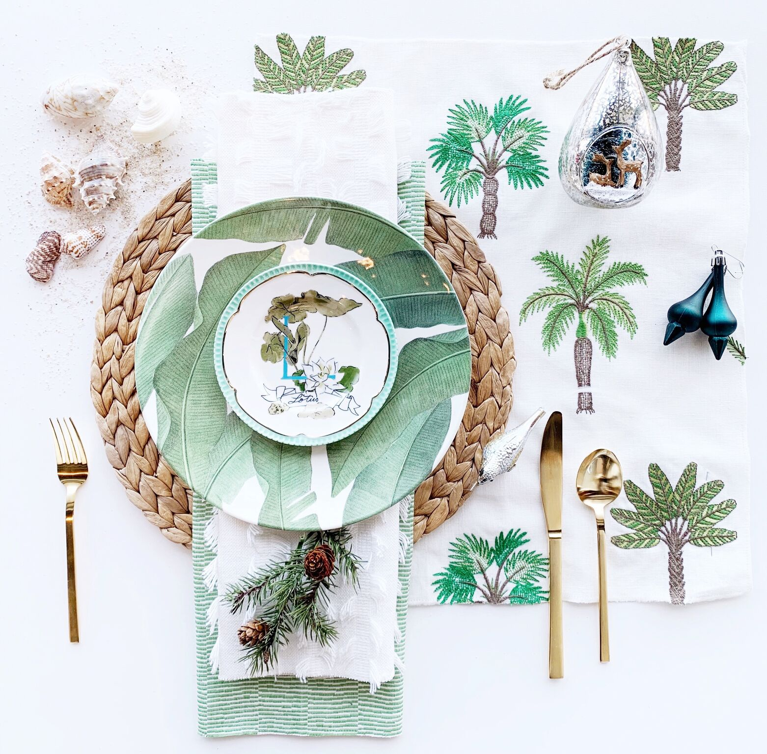 leanne bunnell interiors calgary table setting tropical christmas paradise palm trees green gold organic ornaments