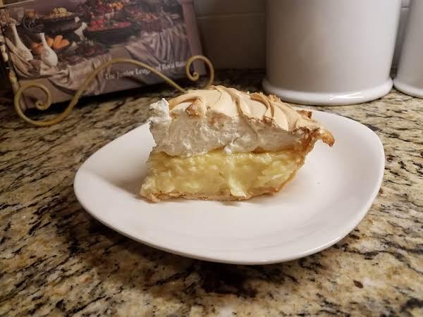 Slice Of Coconut Cream Pie With Double Coconut Flavor.