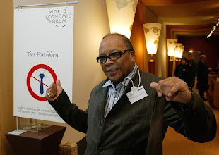 Photo: DAVOS/SWITZERLAND, 21JAN04 - Quincy Jones, Chairman and Chief Executive Officer, The Quincy Jones Listen Up Foundation, USA, takes off his ties at the entrance of the Davos Congress Center during the Annual Meeting 2004 of the World Economic Forum in Davos, Switzerland, January 21, 2004.