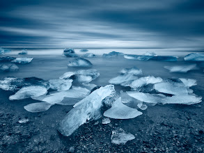Photo: Jokulsarlon, Iceland  I spent the whole morning trying to capture what I hoped would be lots of icebergs rushing in the waves in some sort of an order, while being closest to them possible. Many times I had to run off with the camera because of a stronger wave coming up, many times I just stood tight while it washed my feet (and moved the camera). Many times I was annoyed by waiting for the image to write on card before I could have reviewed it to find out that the original composition turned into a mess. With this one, I was lucky.  Share if you like it. :-)