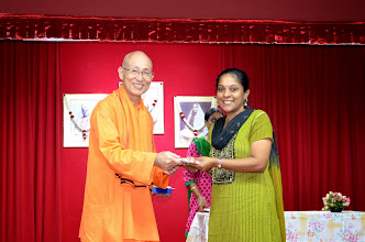 Photo: Mrs Akila, Volunteer receiving a token of appreciation from Swamiji