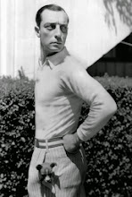 Photo: Buster Keaton's 'puppy photo' at least makes sense for his stature as a comic.  Glamour is downplayed, even as Keaton's pose allows us to admire his torso.