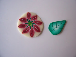 """Photo: Red Pearl Poinsettia Flower:  $3.50 per inch long with a Diameter of 1/2"""" inch around, $7.90 per inch long with Diameter of 3/4"""". The leaf is $2.50 per inch long with 5/8"""" x 3/8"""" face."""
