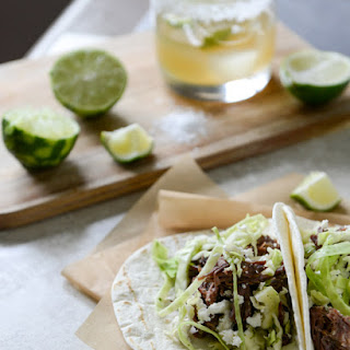 Crockpot Short Rib Tacos with Salted Lime Cabbage and Queso Fresco.